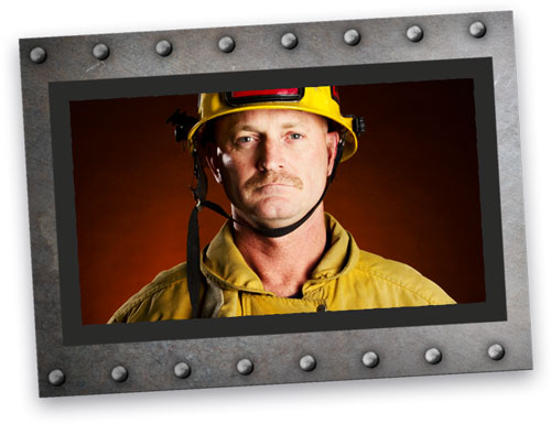 fireman in uniform surrounded by a silver metal frame